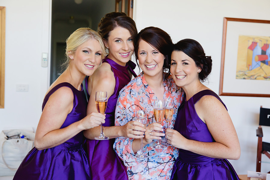 bride-with-her-bridesmaids-relaxing-with-a-champagne