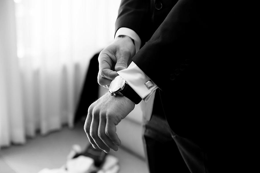 groom-adjusting-his-shirt
