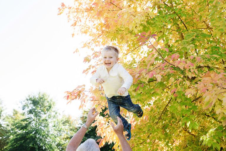 dad-throwing-his-son-in-the-air