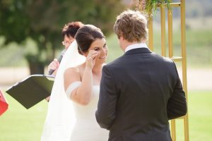 bride-wiping-a-tear-during-the-ceremony