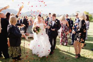flower-petals-being-thrown-at-the-bride-and-groom