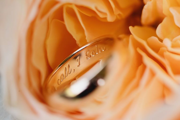 detail of the engraving in the grooms wedding ring